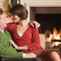 Couple resting by fireplace