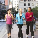 Group Of Women Power Walking On Urban Street