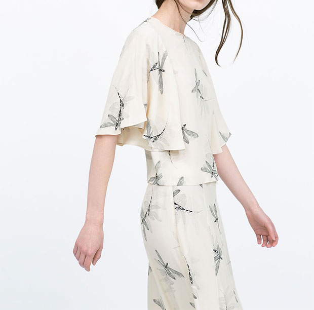 GET THE LOOK: Zara, Printed Top With Cape Sleeves, $69.90 >
