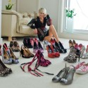 Mature woman with collection of shoes
