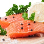 Fresh salmon with spices isolated on the white background