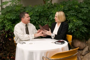 Businesspeople with check at dining table