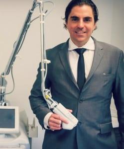 Dr John Antonetti holding laser