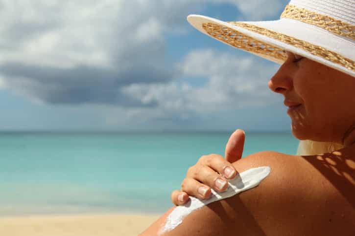 girl aplying  sun protection cream