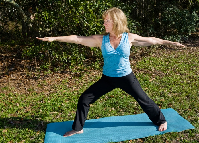 Mature Woman Yoga - Warrior Asana