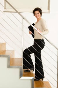 Portrait of a businesswoman climbing up stairs