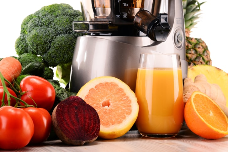 juicer with organic fruits and vegetables