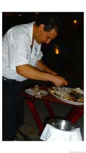Milos Antonios serving