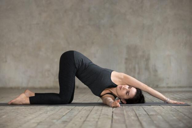 woman doing thread the needle yoga pose