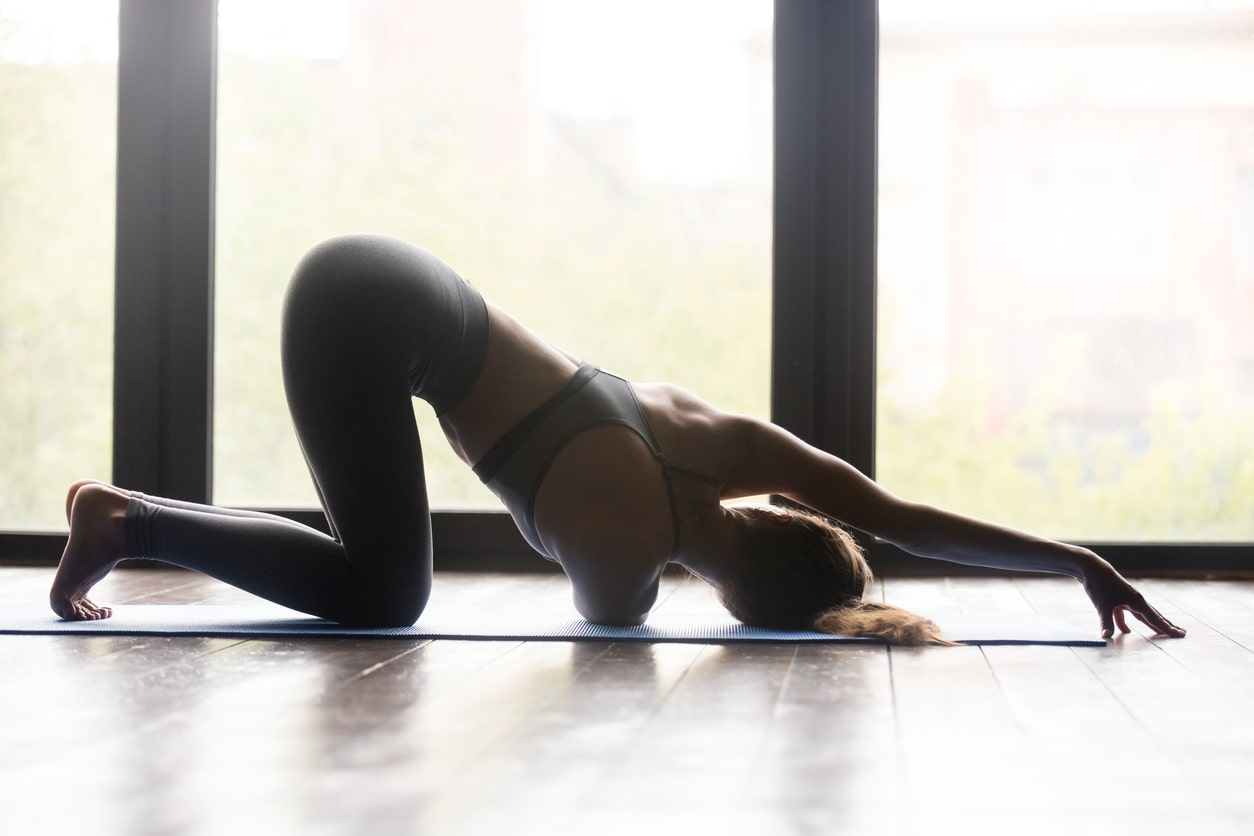 Threading the needle yoga pose view from rear