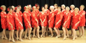 Roslyn Handy Dancers perform 'Sing, Sing, Sing' with Wendy in the center.