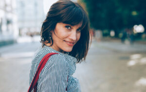 Types of Bangs - woman with short hair and side-swept bangs