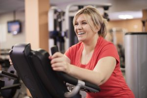 Woman working out on a stairmaster to counteract overeating
