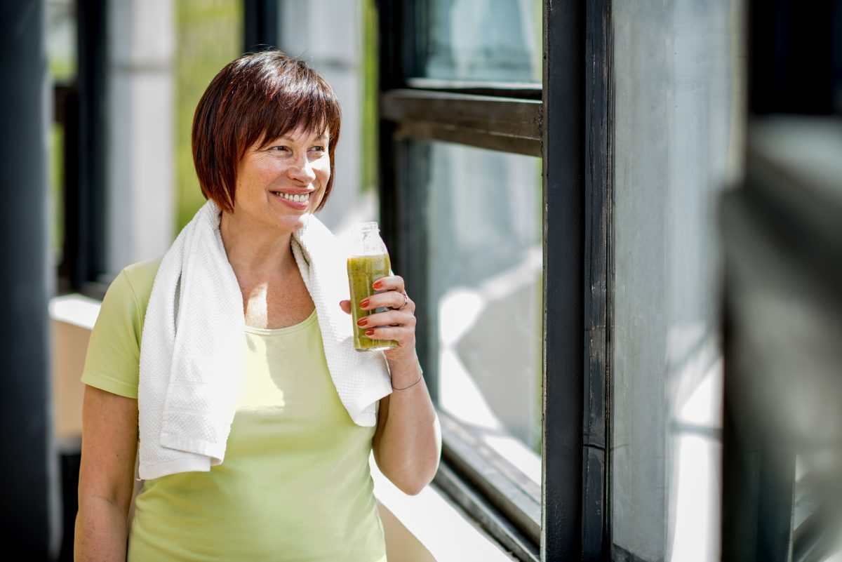 Woman eating a protein shake.