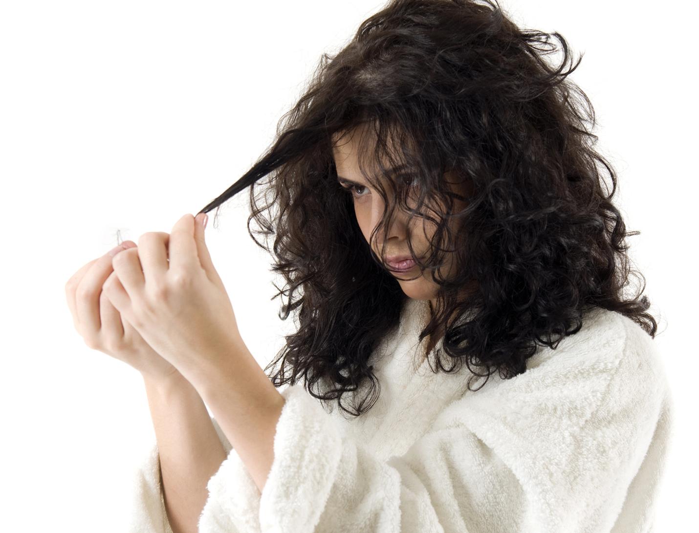 hair loss - dark haired woman