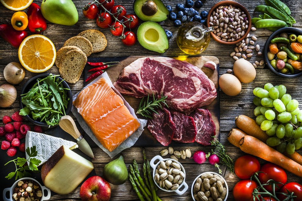 protein sources example includes fish, red meat, fruits, vegetables, and legumes.