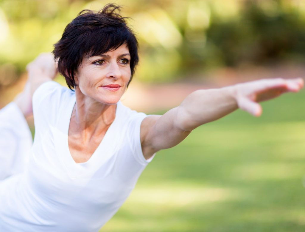 healthy middle aged woman stretching