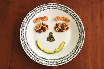 Food on a plate creating smile face
