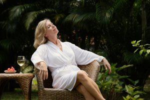 woman sunbathes - wellness retreats