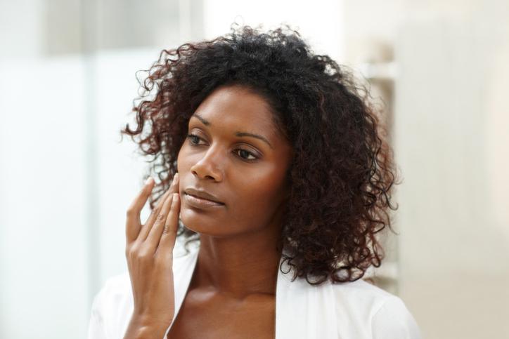 Woman applying anti-aging skin cream