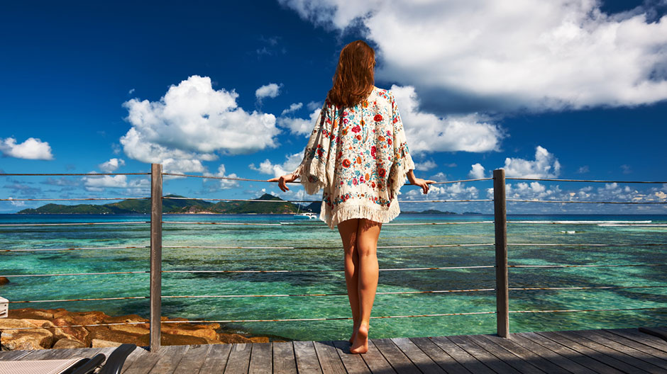 Woman in a caftan standing on a pier
