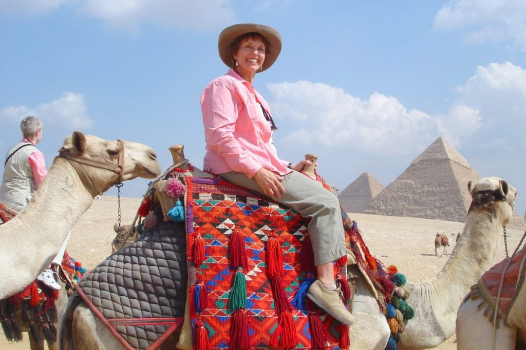 woman on Camel Pyramids Egypt