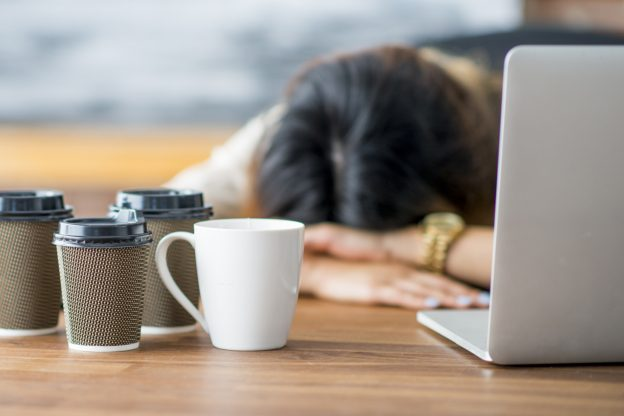 Tired Woman and crashing fatigue from menopause