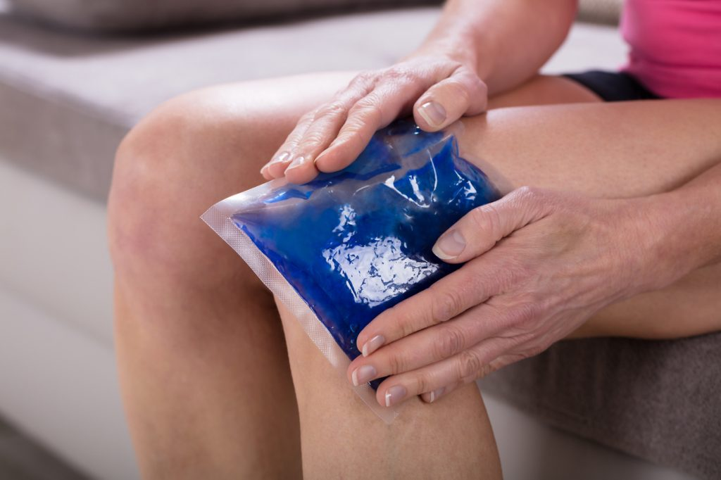 Woman Icing Knee