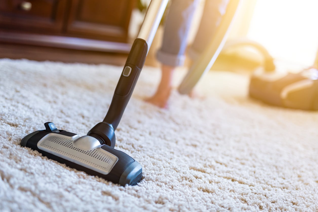 Woman Vacuuming for exercise