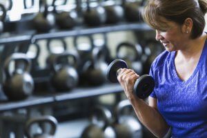 Woman Lifting Weight to help with gaining muscle after 50