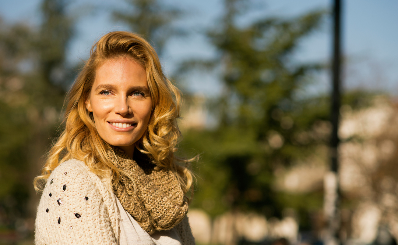Fall hair trends - woman with lovely hair wearing a scarf