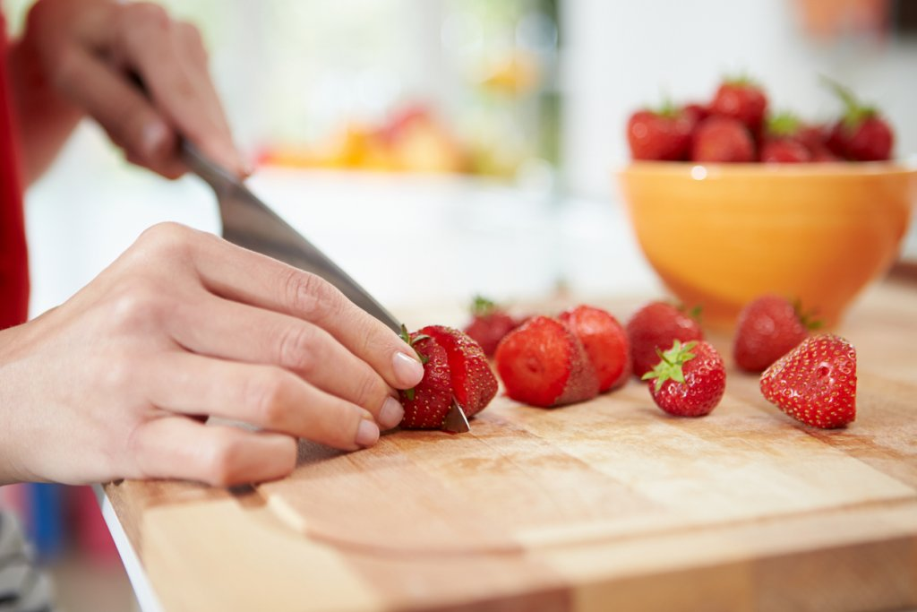 Woman Cutting Strawberries