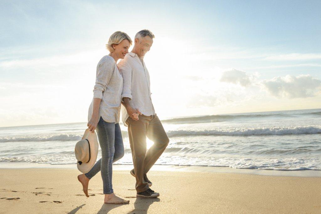 Mature Couple Walking the Beach