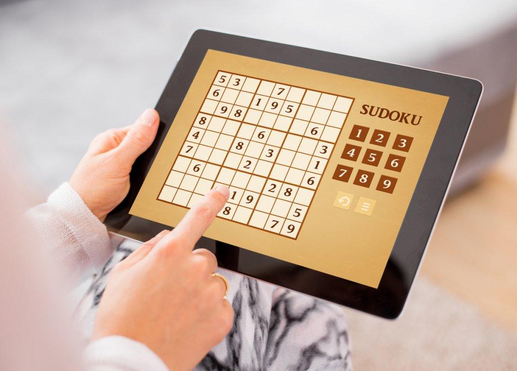 Woman Playing Sudoku