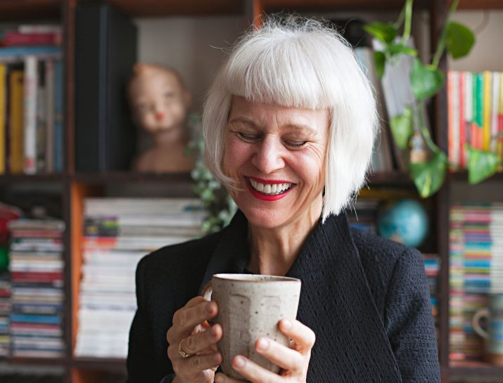 white haired woman laughing