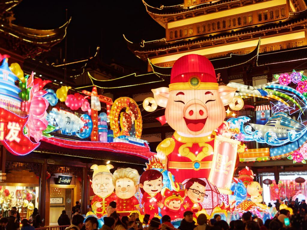 Lantern Festival in the Chinese New Year( Pig year), night view of colorful lanterns and crowded people walking in Yuyuan Garden.