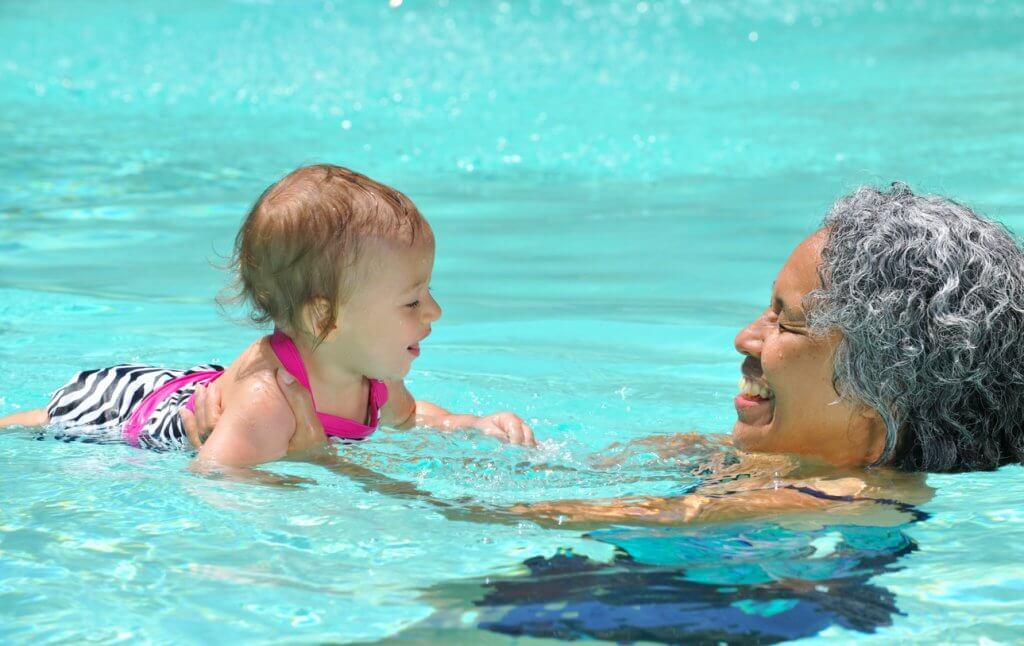Woman Swimming with Grandchild