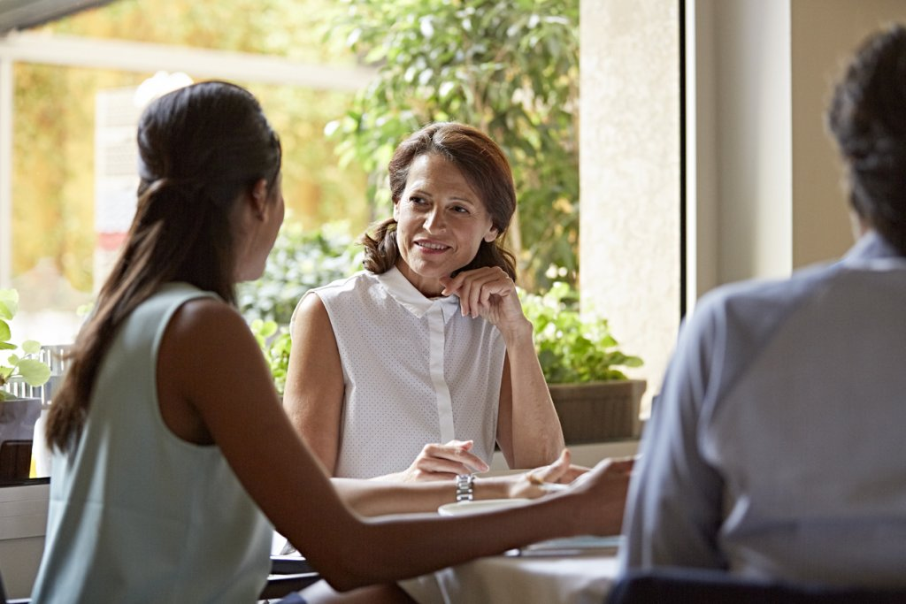 Woman Talking to Coworkers