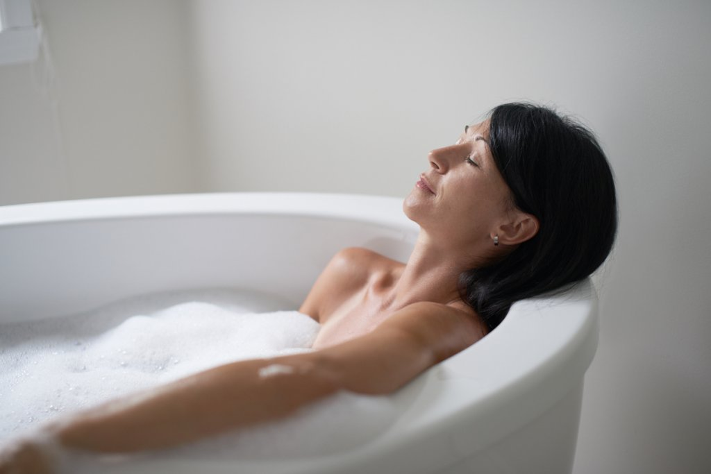 Woman Taking a Hot Bath