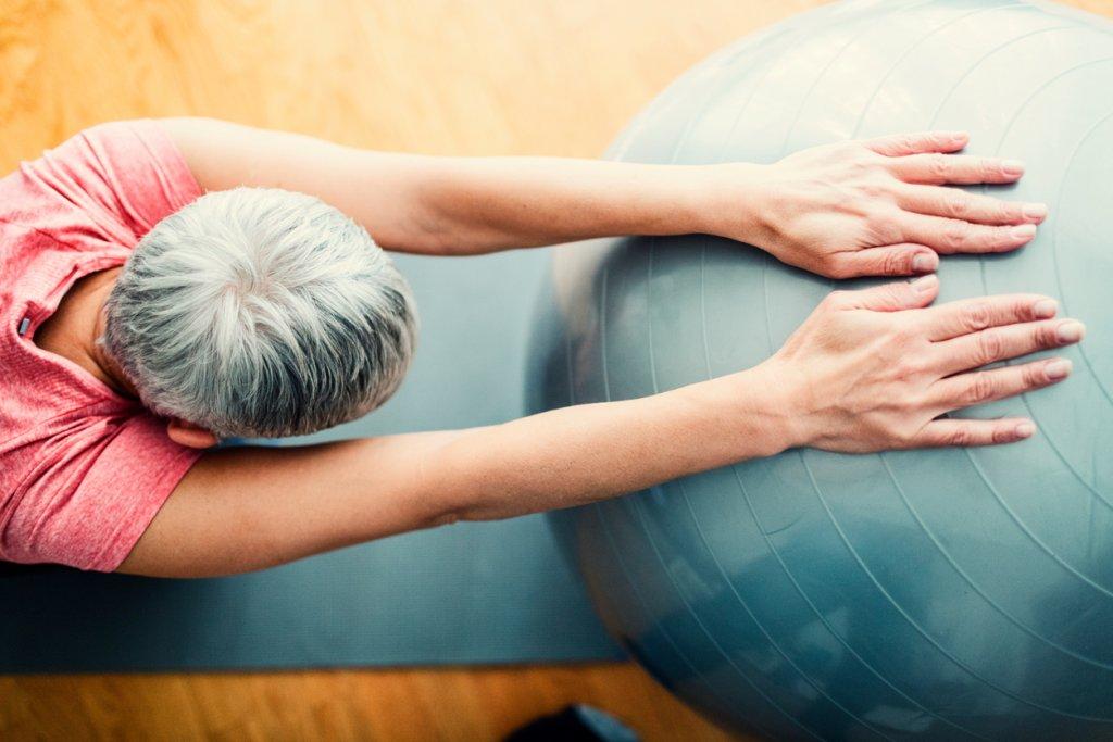 Mature Woman Exercising at Home