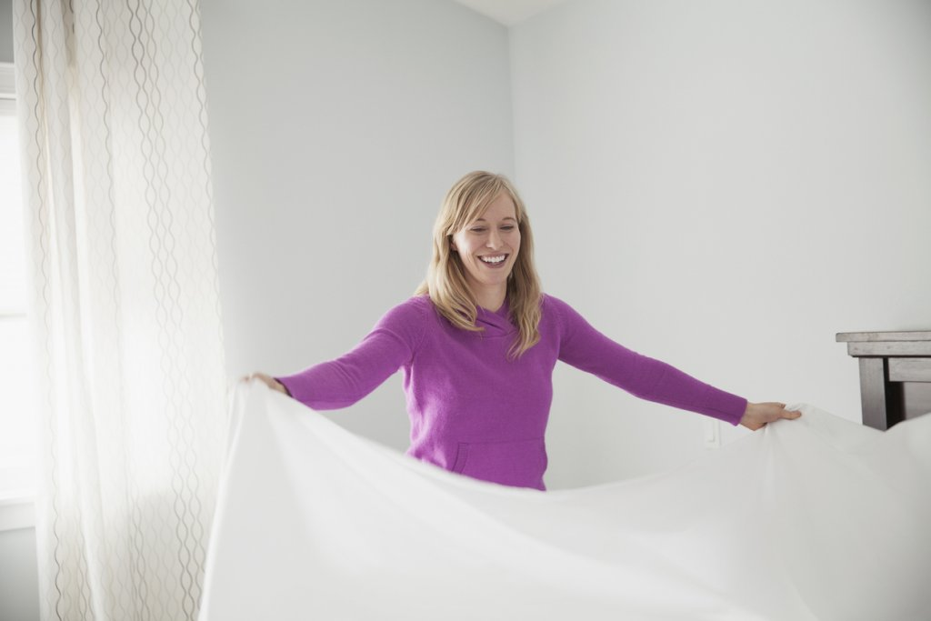 Mature Woman Making a Bed