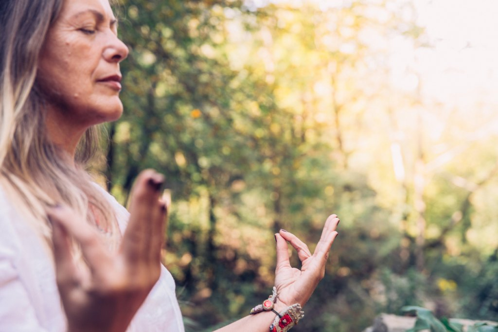 Mature Woman Meditating Outdoors
