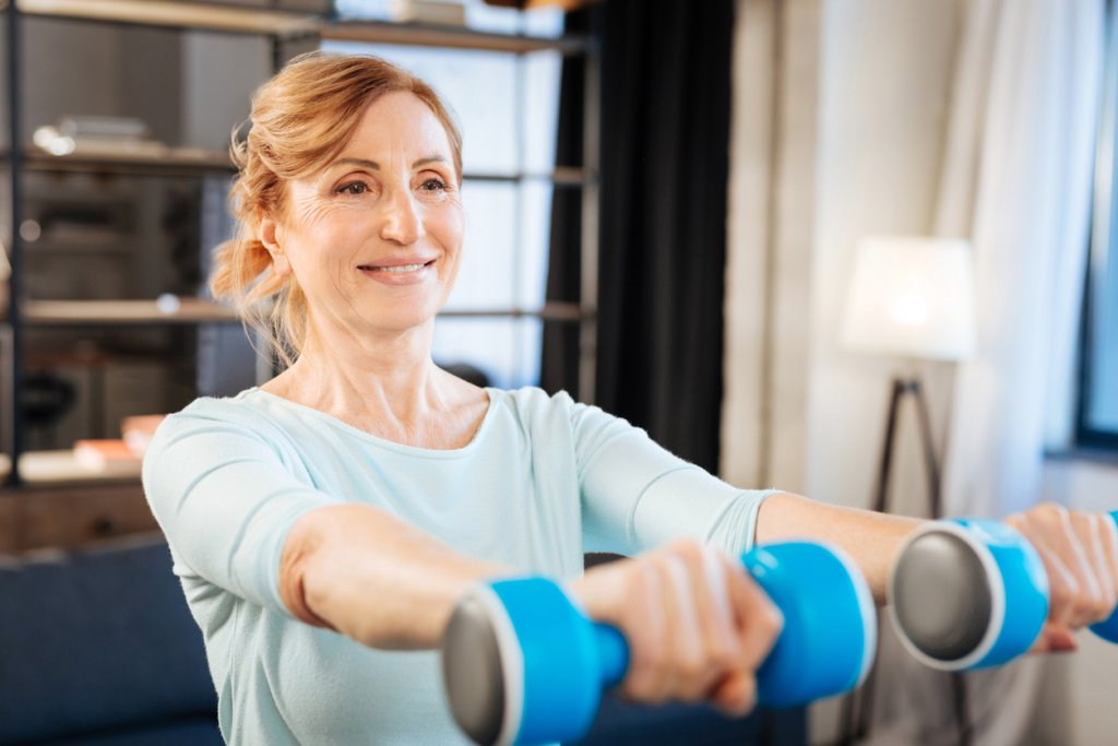 Mature Woman Using Weights
