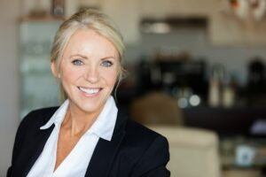 Professional hairstyles for mature women - woman in an office in business attire