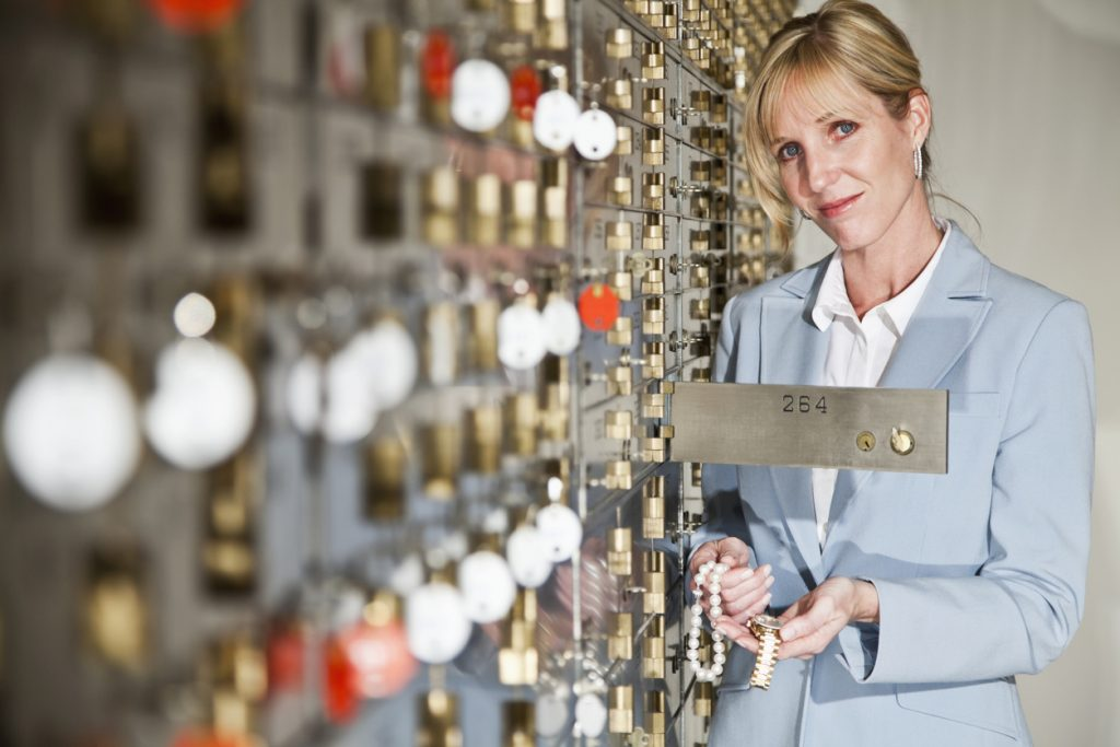 Will legacy Woman putting jewelry in safety deposit box