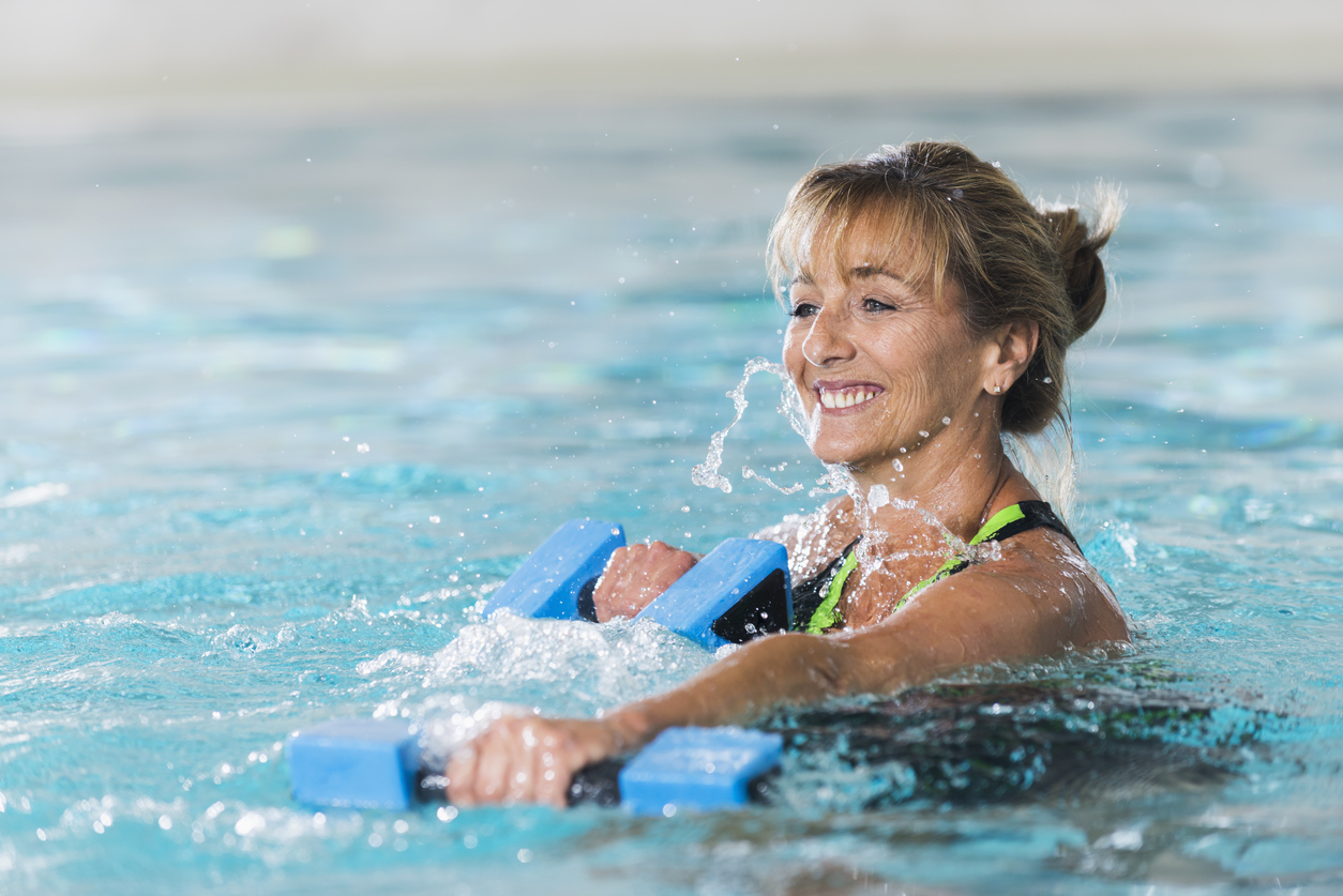 Woman working out her upper arms in the pool