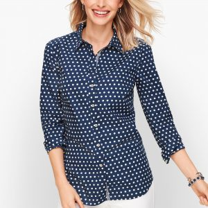 A button down long sleeve shirt makes a classic transition piece
