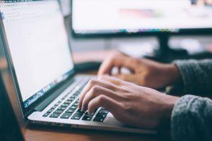 unsplash hands researching laptop