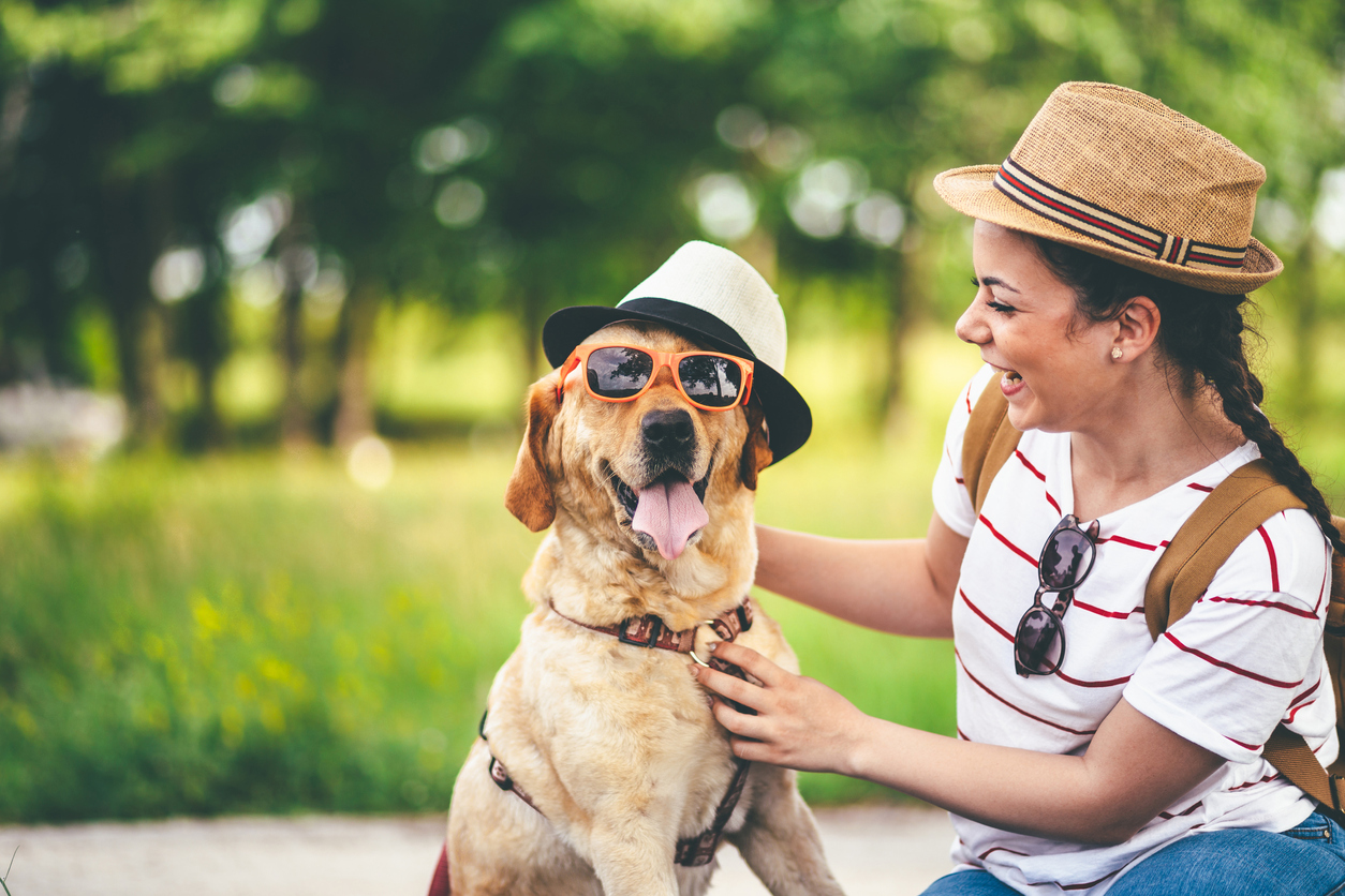 Dog and woman wearing cool summer accessories