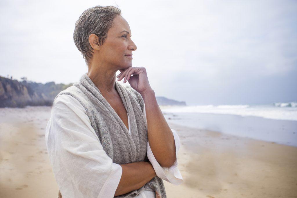 women inspiring women Senior Black Woman Relaxing on Beach